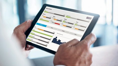 Cropped_shot_of_a_businessman_using_a_digital_tablet_with_graphs_on_the_screen