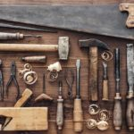 Collection_of_vintage_carpentry_tools_on_an_old_workbench:_woodworking,_craftsmanship_and_handwork_concept,_flat_lay