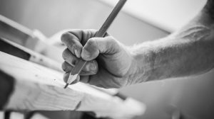 Passionate_Carpenter_at_Work._Woodwork_Concept._Carpenters_Hand_with_Pencil_Marking_the_Cut.