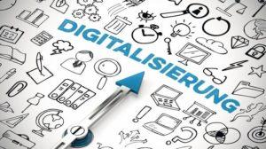 Digitalisierung_Konzept_mit_Icons_und_Kompass_Pfeil_der_auf_Schriftzug_zeigt