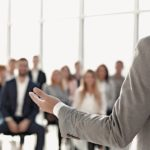 close_up._image_of_a_speaker_giving_a_lecture_at_a_business_seminar_close_up._image_of_a_speaker_giving_a_lecture_at_a_business_seminar