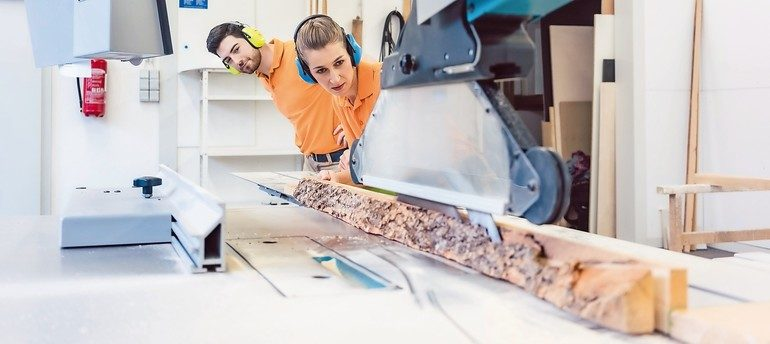 Carpenter_man_and_woman_working_in_workshop_as_a_team