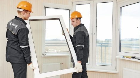 two_windows_installation_workers_installing_double-glass_pane