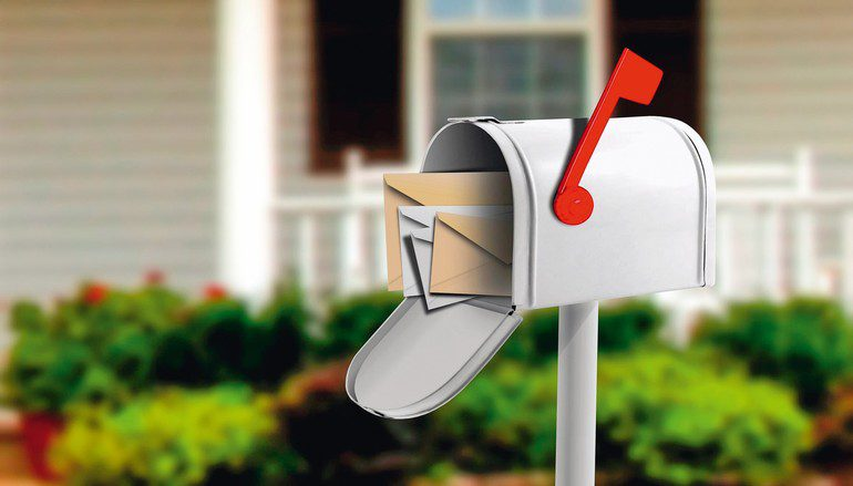 24187629_-_white_mail_box_in_front_of_a_house
