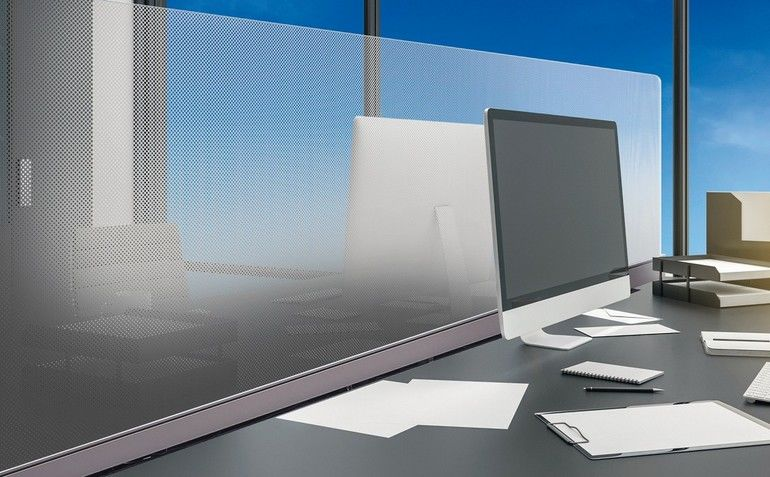 Close_of_of_desktop_in_white_coworking_office_interior_with_city_view,_daylight,_supplies_and_coffee_cup._3D_Rendering_