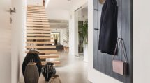 Designed_wooden_stairs_in_spacious_white_loft_with_decorative_lanterns_from_travel