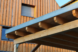 woodwork_at_the_roof_of_a_carport_near_residential_building