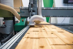 CNC_woodworking_wood_processing_machine,_modern_technology_in_the_industry.