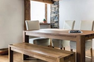 wooden_table_in_dining_room_under_mezzanine